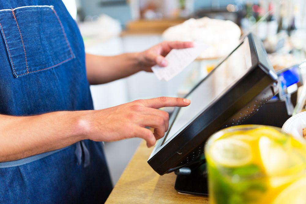 hospitality worker uses POS system to improve his business